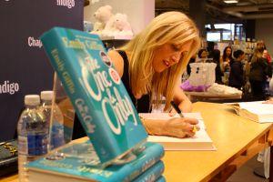 Emily signing books